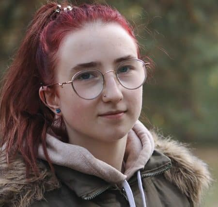 English culture woman smiling with glasses