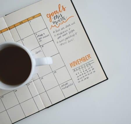 talk about future English calendar with coffee cup and pen